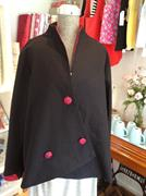 Black linen jacket with patterned fabric buttons and lining